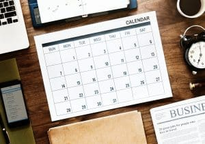 calendar, phone, newspaper, laptop schedule